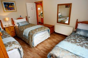A bed or beds in a room at Almanii B&B