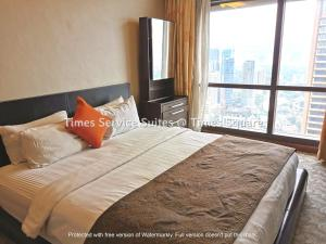 A bed or beds in a room at Times Service Suites @ Times Square