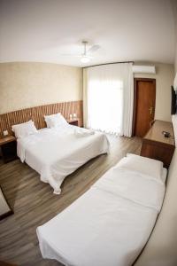 Cama ou camas em um quarto em Hotel Fazenda Horizonte Belo