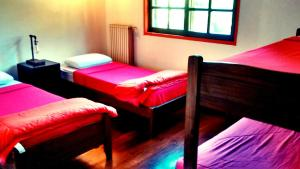 A bed or beds in a room at Lo del Colo