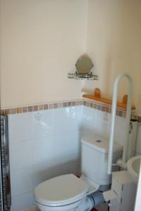 A bathroom at Harlequin Guest House with parking