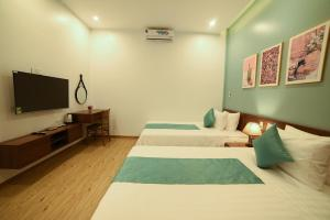 A bed or beds in a room at AnAn Homestay Huế