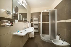 Ванная комната в Hotel Sovereign Prague