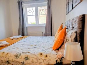 A bed or beds in a room at The Perfect Stay - Manchester