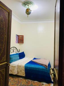 A bed or beds in a room at Hôtel Dar Youssef