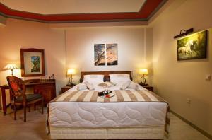 Postelja oz. postelje v sobi nastanitve Hotel Rodovoli