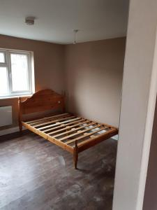 A bed or beds in a room at Studio Flat