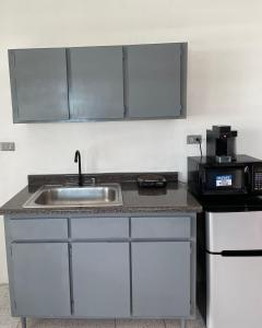 A kitchen or kitchenette at Spacious and beautiful apartment near to airport
