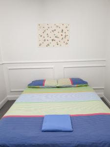 A bed or beds in a room at BK Hostel