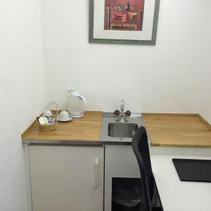Küche/Küchenzeile in der Unterkunft Metropol