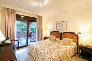 A bed or beds in a room at Vasari Resort