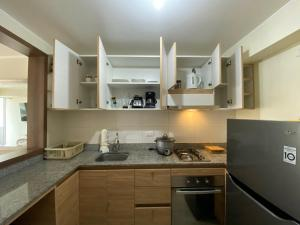 A kitchen or kitchenette at Departamento en Miraflores con Surquillo
