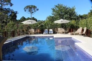 The swimming pool at or close to Pousada Jardim da Luz