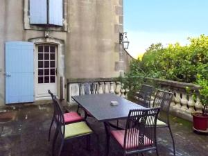 A balcony or terrace at Apartment with one bedroom in SaintRemydeProvence with shared pool enclosed garden and WiFi