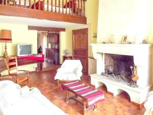 A seating area at Apartment with one bedroom in SaintRemydeProvence with shared pool enclosed garden and WiFi