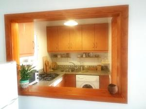 A kitchen or kitchenette at House with one bedroom in El Chaparral with wonderful sea view enclosed garden and WiFi 2 km from the beach