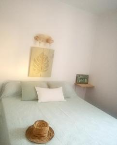 A bed or beds in a room at House with one bedroom in El Chaparral with wonderful sea view enclosed garden and WiFi 2 km from the beach