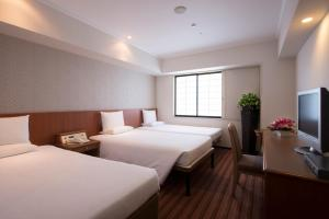 A bed or beds in a room at International Garden Hotel Narita