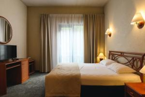 A bed or beds in a room at Отель MORE SPA & RESORT