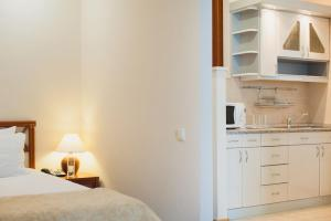 A kitchen or kitchenette at Отель MORE SPA & RESORT