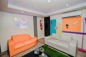 A seating area at D8 Hotel Express
