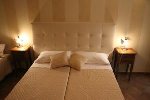 Letto o letti in una camera di B&B Le Foglie D'Argento
