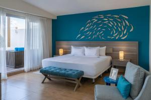 A bed or beds in a room at Radisson Blu Resort & Residence Punta Cana All Inclusive
