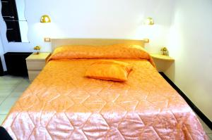 A bed or beds in a room at B&B Galatea