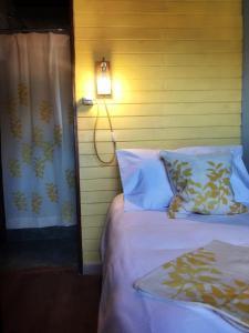 Una cama o camas en una habitación de Lago Viedma B&B