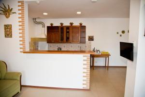 Кухня или мини-кухня в Отель Маленькая Италия