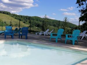 The swimming pool at or near Village Bord de Ciel
