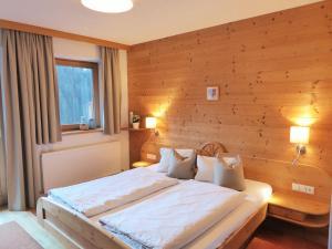 Ein Bett oder Betten in einem Zimmer der Unterkunft Alpbacher Appartementhaus Johannes