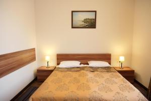Кровать или кровати в номере Отель Петровский