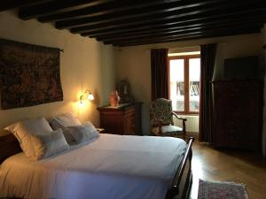 A bed or beds in a room at La Maison d'Euterpe