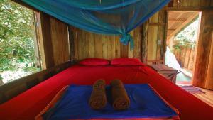 Ein Bett oder Betten in einem Zimmer der Unterkunft Lonely Beach