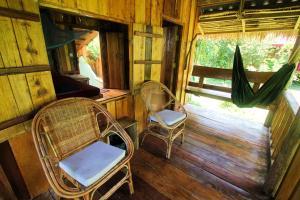 Ein Sitzbereich in der Unterkunft Lonely Beach