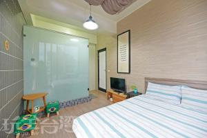 A bed or beds in a room at Penghu 123 V-Stone