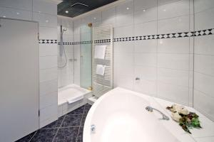 A bathroom at Hotel Mennicken