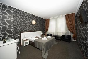 A bed or beds in a room at Тайм 2
