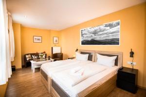 Ein Bett oder Betten in einem Zimmer der Unterkunft Hotel Stadtschänke