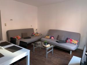 Ein Sitzbereich in der Unterkunft Ferienwohnung Jena Stadt
