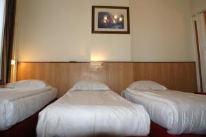 Cama ou camas em um quarto em Hotel de Westertoren