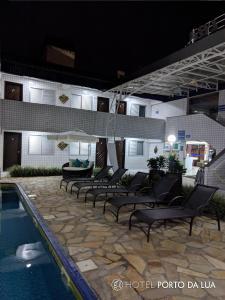 A piscina localizada em Hotel Pousada Porto da Lua ou nos arredores