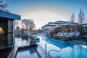 The swimming pool at or close to Amadore Hotel Restaurant De Kamperduinen