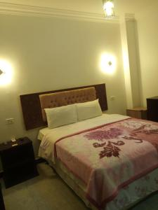 A bed or beds in a room at Arabian Nights Hostel
