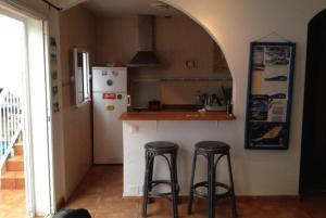 A kitchen or kitchenette at KAKTUS BEACH House