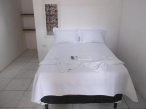 A bed or beds in a room at Pousada Penharol