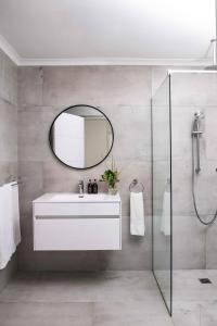 A bathroom at Bay Reflections Camps Bay Luxury Serviced Apartments