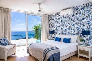 A bed or beds in a room at Bay Reflections Camps Bay Luxury Serviced Apartments