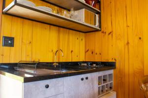A kitchen or kitchenette at Cappio Pousada e Lazer